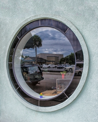 Photo of street reflection in a window